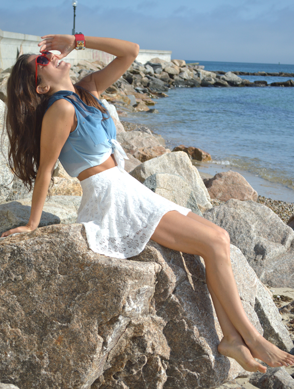 white summer skirt with tied blue ombre blouse and red sunglasses
