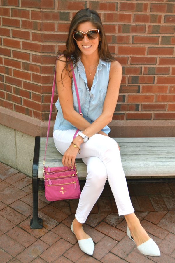 White pants, chambray blouse and a pink crossbody bag