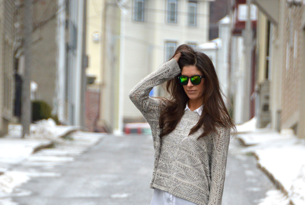 green reflective sunglasses and sweater