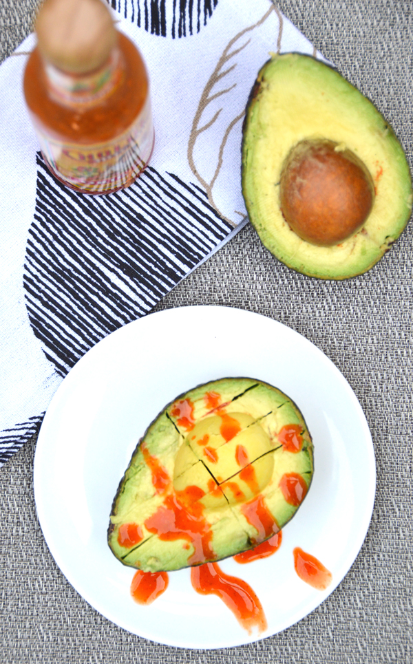 Easy snack: avocado slices and hot sauce