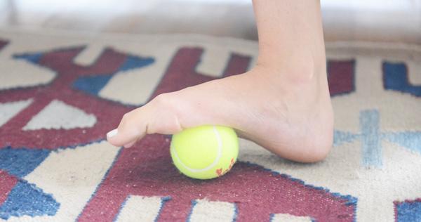 4 Self-Massage Tools I Love - tennis ball for massaging feet
