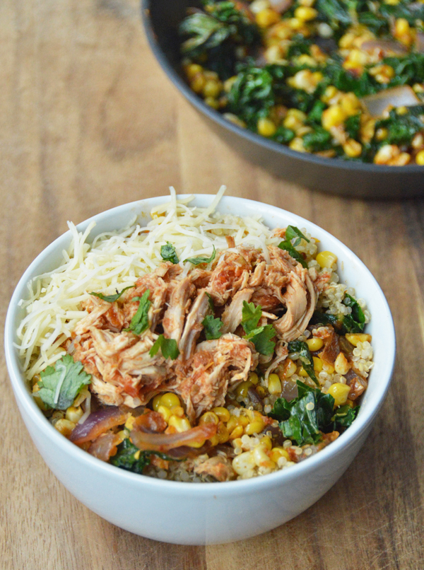 Mexican Shredded Chicken (easy to make in the slow cooker!) over quinoa and a corn kale saute