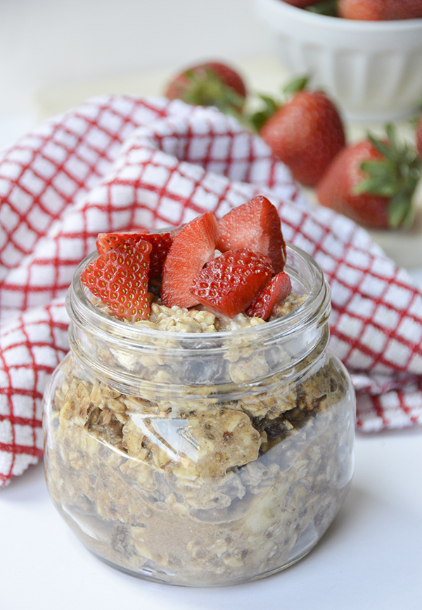 Cinnamon Raisin Overnight Oats topped with Strawberries