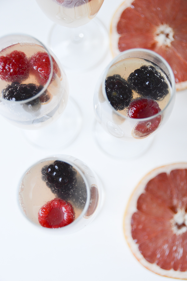 Grapefruit Mimosas with Frozen Berries