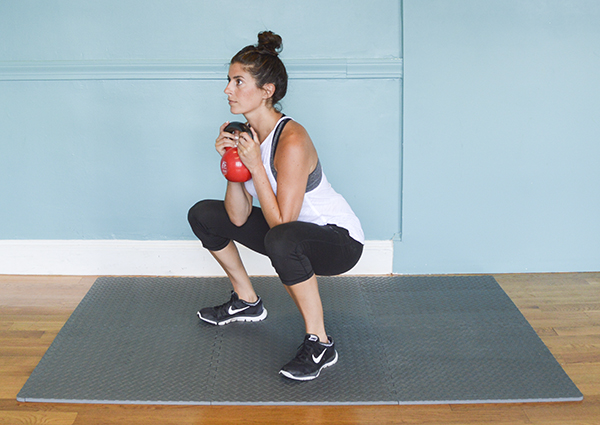 This kettlebell circuit workout will take you 18 minutes to complete (45 seconds work/15 seconds rest). You'll then do a 3-minute core AMRAP to finish.